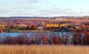 At Clay Cliffs Natural Area, views of fall leaves along both Lake Leelanau and Lake Michigan give visitors a quintessentially Leelanau experience. Photo by Trish Petrat.