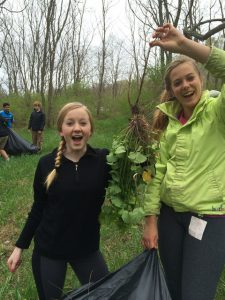 Girls holding garlic mustard web