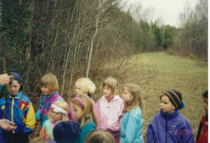Ellen Posner, in blue coat, second from right, on an Earth Day tree planting outing.